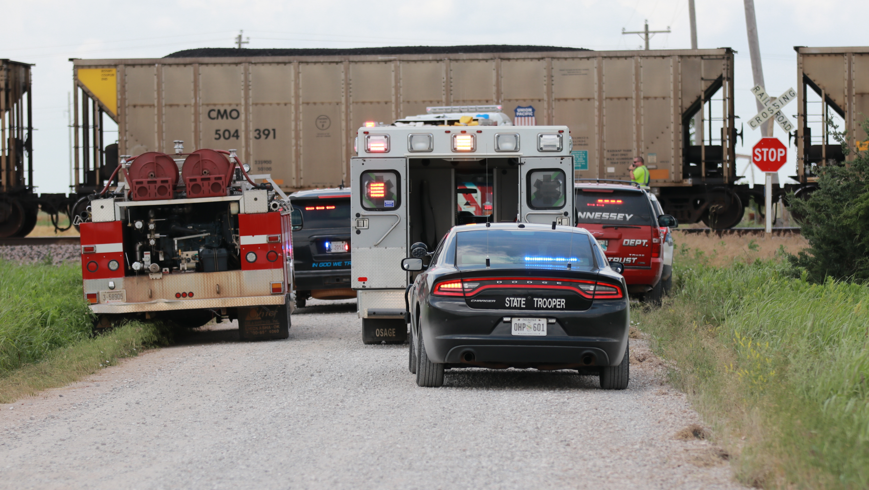 TRAIN VS CAR NORTH OF HENNESSEY